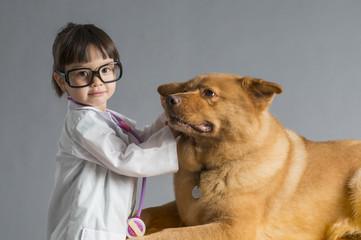Child playing veterinarian