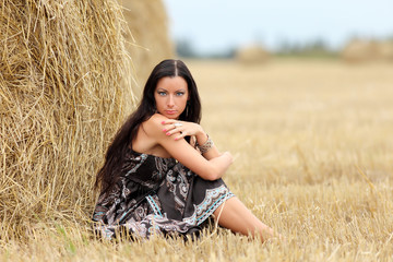 portrait of a girl in a field with hay
