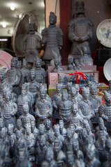 Terracotta army statues at a market stall