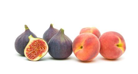 figs and peaches closeup on a white background
