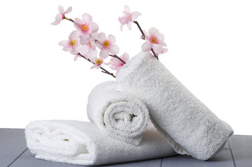 white towels with peach flowers on table