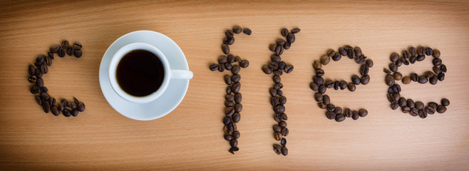 Inscription of coffee from coffee beans. Vignetting.