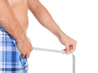 Man measuring his penis size