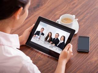 Fototapete - Woman Video Conferencing On Digital Table