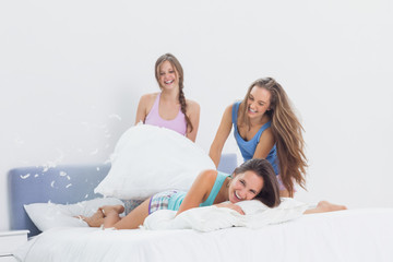 39bd66dc60 Happy girls having fun at slumber party in bed