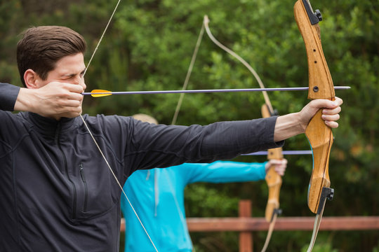 Handsome man practicing archery