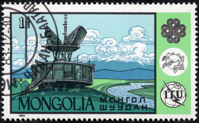 stamp printed in Mongolia showing satellite