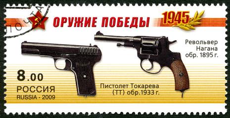 RUSSIA - 2009: shows Nagant M1895 Revolver, Pistolet Tokareva TT