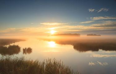 Golden sunrise at river