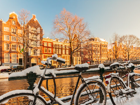 Bicycles covered with snow during winter in Amsterdam