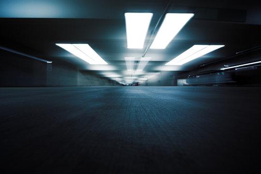 Dark parking garage industrial room interior. Zoom blur.