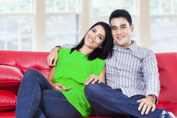 Happy young couple in a living room