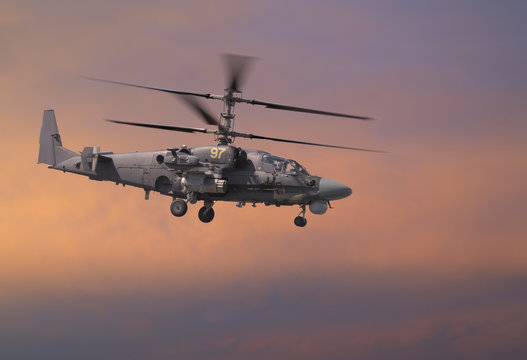 Attack helicopter in red sky
