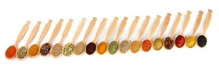 Aluminium Prints Herbs 2 Assortment of spices in wooden spoons, isolated on white