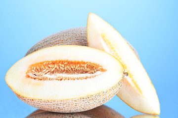 Ripe melons on blue background