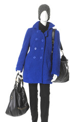 female clothing in hat with blue coat on mannequin