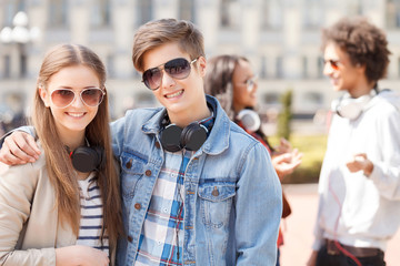 Teenage friends. Two cheerful teenage friends standing close to