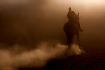 Horse riding in the dust