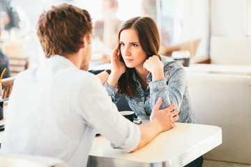 Couple fighting young woman about to cry