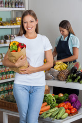 Woman Holding Grocery Bag At Supermarket