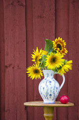 summer time sunflowers beautiful bouquet in elegant pitcher