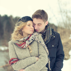 beautiful couple embracing in winter