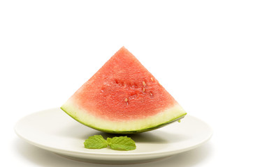 slice of watermelon with a triangle shaped on plate