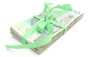 Pile of banknotes with green ribbon on white background