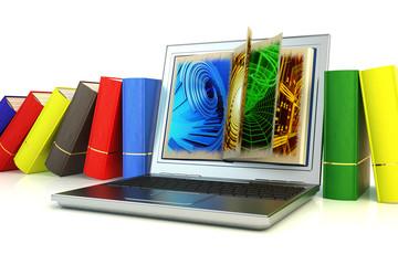 Modern laptop between books