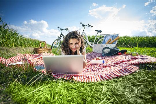 Woman, picnic and computer!