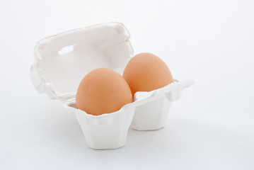 Two Eggs in white tray