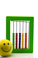 Bright  toy abacus and  Smiling ball , on white