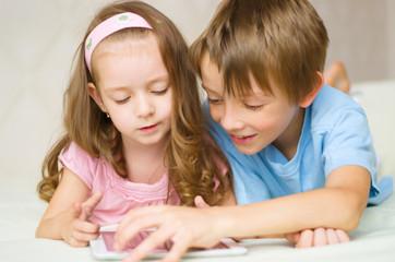 children using tablet computer