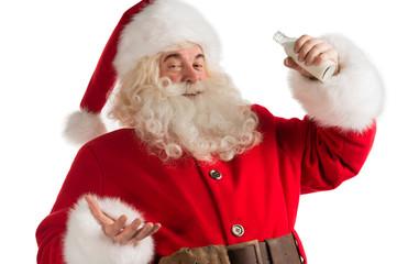Santa Claus drinking milk from bottle