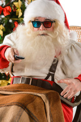 Santa Claus sitting in rocking chair near Christmas Tree at home