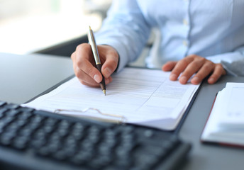 Businesswoman hands pointing at business document