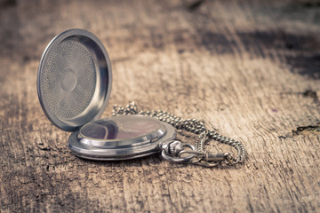 Vintage Pocket watch at old wood background