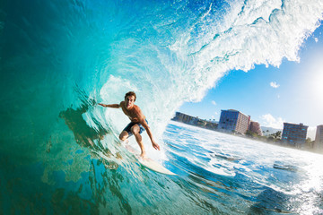 Wall Mural - Surfer on Blue Ocean Wave in the Tube Getting Barreled