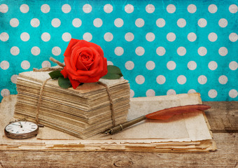 old love letters and postcards with pink rose flower