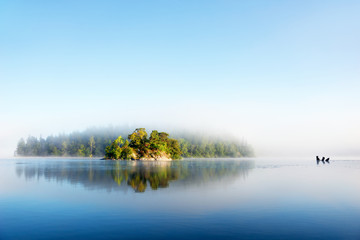 Tuinposter Eiland Island on foggy morning