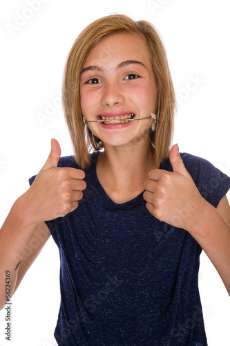 Happy girl with headgear giving two thumbs up\