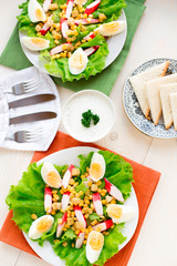 Salad with eggs, crab sticks and corn