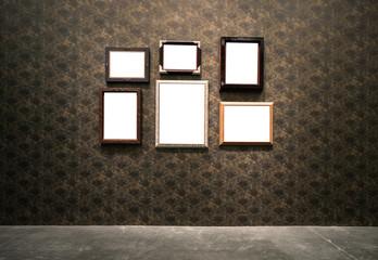 Ornate gold frame at grunge wallpaper