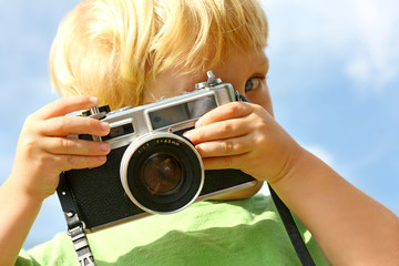 Child Taking Picture with Vintage Camera