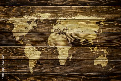 World map on wood background\