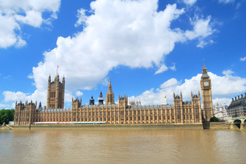Big Ben Tower and Houses of Parliament in London under blue and
