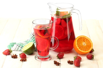 sangria in jar and glass with fruits,
