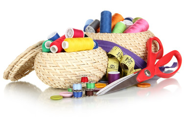Wicker baskets with accessories for needlework isolated on