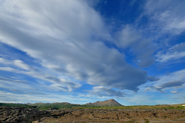Iceland - clouds and blue sky landscape on  the lava