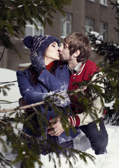 Happy lovers in winter